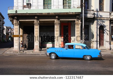 HAVANA - FEBRUARY 24: Cubans drive a Classic American car on February 24, 2011 in Havana. Recent change in law allows the Cubans to trade cars after it was forbidden for many years. - stock photo
