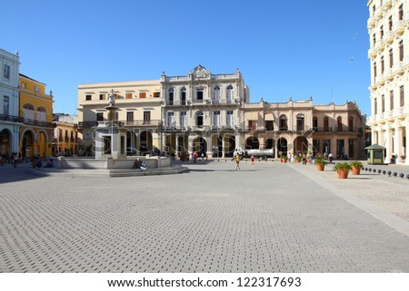 HAVANA - FEBRUARY 23: Tourists visit Plaza Vieja on February 23, 2011 in Havana. Havana's Old Town is a UNESCO World Heritage Site and is Cuba's most visited area. - stock photo