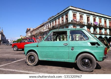 HAVANA - JANUARY 30: People walk past old Fiat 126 car on January 30, 2011 in Havana. Recent change in law allows the Cubans to trade cars again. Most cars in Cuba are very old because of the old law. - stock photo
