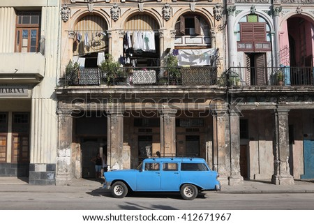 HAVANA -  OCTOBER 28, 2012: Cubans woman smoking cigar in Havana, Cuba on  October 28, 2012. - stock photo