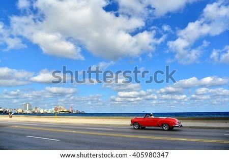 Havana - seafront and red oldtimer. Havana's  promenade, in Havana,Cuba. Havana and americam car, sea. Havana, Cuba  background.  - stock photo