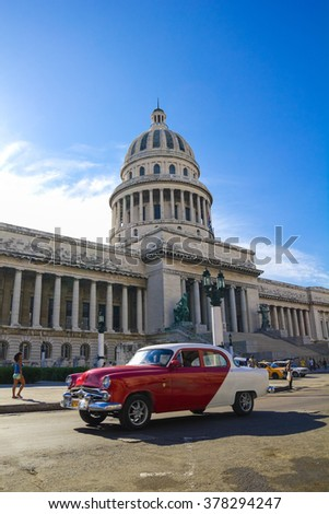 HAVANA, SEP 7: A vintage car circulating in front of the Capitol on September 23, 2011 in Havana, Cuba. Cubans, unable to buy newer models, keep thousands of them running. - stock photo