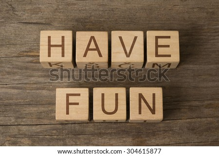 HAVE FUN text on a wooden background - stock photo
