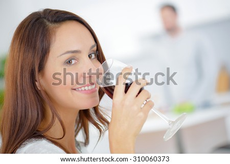 Having a glass of wine at home - stock photo