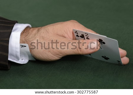 Having an ace up one`s sleeve - stock photo
