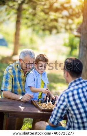 having fun and playing chess at park - stock photo