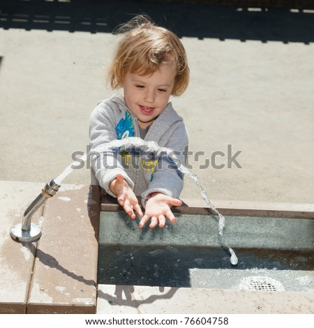 Having fun at playground in the park on sunny afternoon. - stock photo