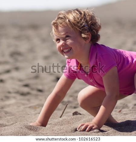 Having fun on the beach on sunny day. - stock photo