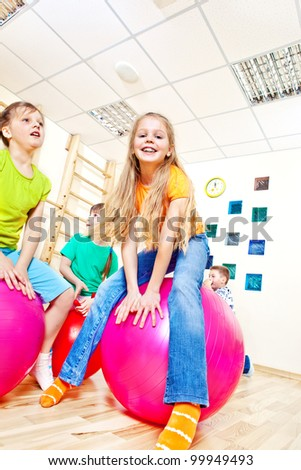 Having fun with gymnastic balls - stock photo