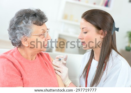 Having her flu jab - stock photo