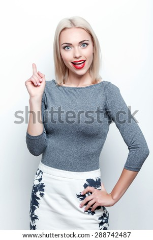 Having idea. Young pretty blond-haired woman standing on white isolated background and pointing upwards with her index finger  - stock photo