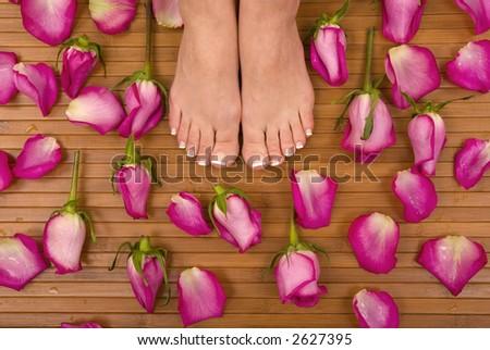 Having spa treatment (pedicured feet) - stock photo