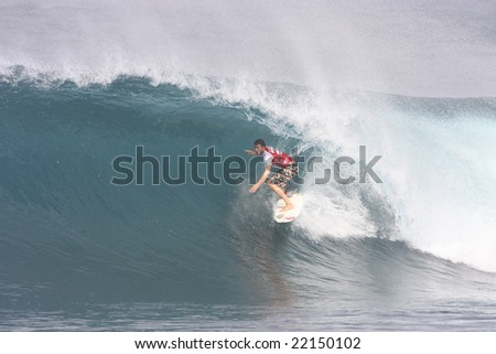 Hawaii - Dec. 10: A competitor during this years Pipemasters event, pulls into a barrel during a heat - Dec. 10, 2008 at Backdoor, Hawaii. - stock photo