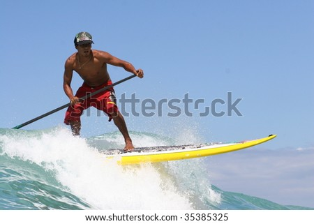 HAWAII - JULY 23: A competitor practices for China's Annual Longboard contest July 23, 2009 at Waikiki, Hawaii. - stock photo