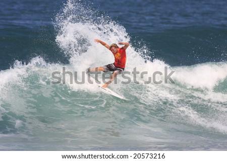 Hawaii - Nov. 13: Dusty Payne performs a radical maneuver during the Reef Hawaiian Pro Nov. 13, 2008 at Haleiwa Beach, Hawaii. - stock photo