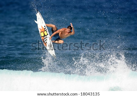 Hawaii - Nov. 2: Surfer Spencer Sterling kicks off the beginning of the winter season with a nice aerial Nov. 2, 2007 at Rocky Point, Hawaii. - stock photo