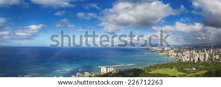 Hawaii panoramic with rainbow over the city skyline - stock photo