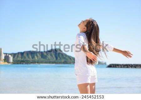 Hawaii travel hawaiian woman happy carefree in front of Honolulu Diamond Head mountain and Waikiki beach. - stock photo