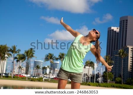 Hawaii travel hawaiian woman happy carefree in front of Waikiki beach. Beauty in the summer sun. - stock photo