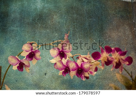Hawaiian orchid with a texture overlay for a vintage look. - stock photo