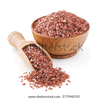 Hawaiian red sea salt in a wooden bowl isolated on white background - stock photo