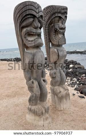 Hawaiian Sacred Carved Idols from Wood resembling images of god that guard the sanctuary of Puuhonua O Honaunau, an ancient refuge on the Big Island of Hawaii - stock photo