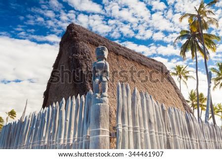 Hawaiian thatched roof dwellings at ancient Hawaiian site Pu'uhonua O Honaunau National Historical Park on Big Island, Hawaii - stock photo