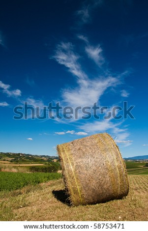 Hay bail with deep blue sky - stock photo