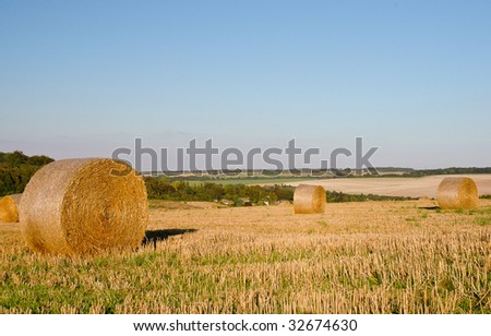 Hay bales on a harvested field in Lullingstone, Kent, England - stock photo