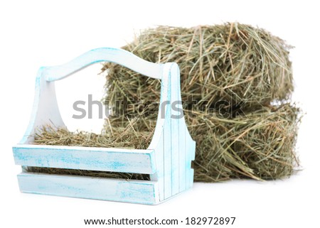 Hay in wooden basket, isolated on white - stock photo