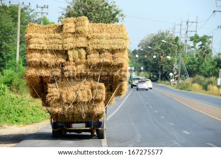 Hay Truck on the Road in Thailand - stock photo