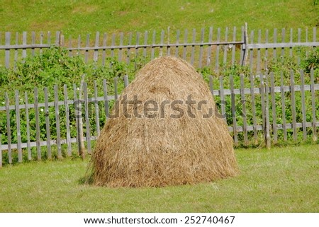 haystack and fence in Sinjajevina mountain, Montenegro - stock photo