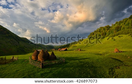 haystacks in the romanian mountains - stock photo