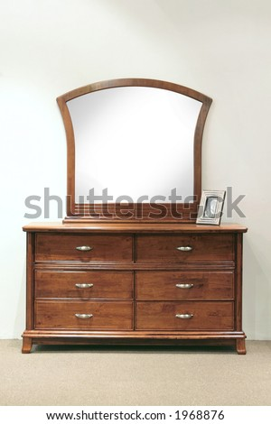 Hazel stained grained rubber wood mirror dresser with drawers for the bedroom - stock photo