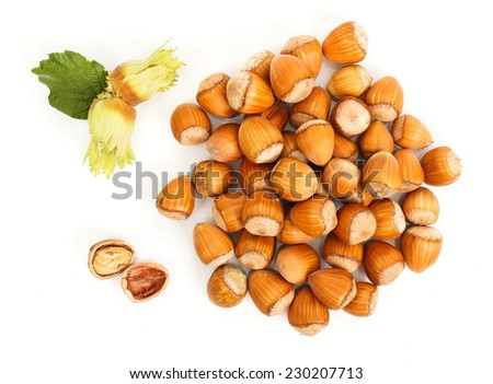 Hazelnut clusters and whole nuts viewed from above - stock photo