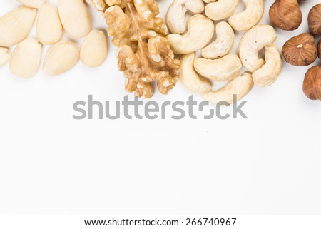 Hazelnuts, Cashews, Walnuts and Almonds with free lower frame copy Space - stock photo