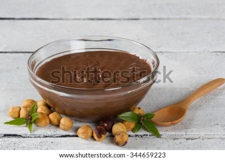 Hazelnuts delicious hot cream into a glass bowl - stock photo