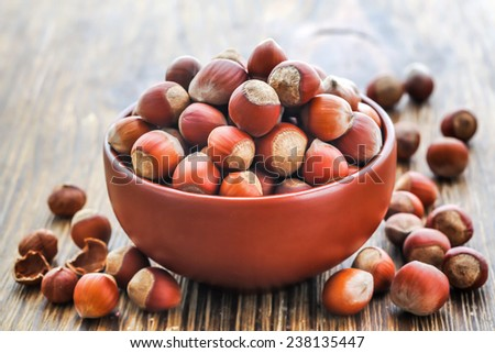 Hazelnuts, filbert on old wooden background - stock photo
