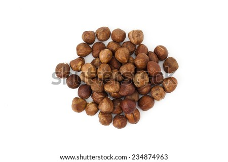 Hazelnuts from above on white background - stock photo
