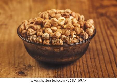 Hazelnuts in bowl - stock photo