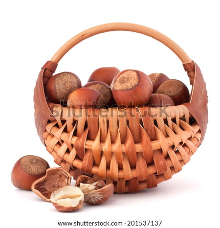 Hazelnuts in wicker basket isolated on white background - stock photo