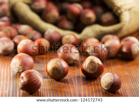 hazelnuts on a wooden table - stock photo