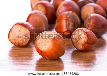 Hazelnuts on the wooden board - stock photo