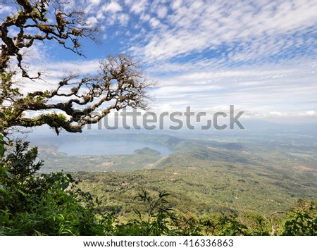 Hazy landscape of the volcanic caldera Lake Coatepeque in Salvador seen from the Cerro Verde National Park - stock photo