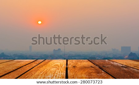 Hazy skyline of Chiang Mai City ,Thailand smog covering buildings with sunrise . - stock photo