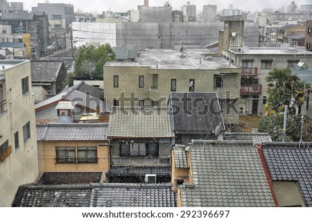Hazy winter morning in typical japanese suburban houses - stock photo