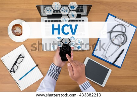HCV  Doctor working at office desk and using a mobile touch screen phone, computer and medical equipment all around, top view, coffee - stock photo