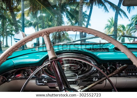HDR Cuba blue american classic carpark near the beach with interior view - stock photo
