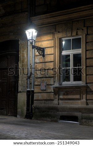 HDR image of a modern LED light source mounted in an old lantern in a renovated street in Zagreb, Croatia. - stock photo