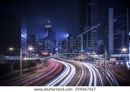 HDR image of Hong Kong rush and busy traffic captured at night in central district - with vintage color tone tuned - stock photo